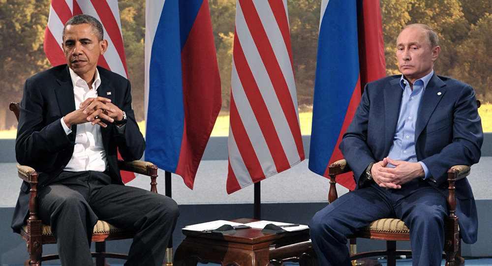 Russian President Vladimir Putin, right, and U.S. President Barack Obama have a meeting within the framework of the G8 summit in Northern Ireland, 17 June 2013