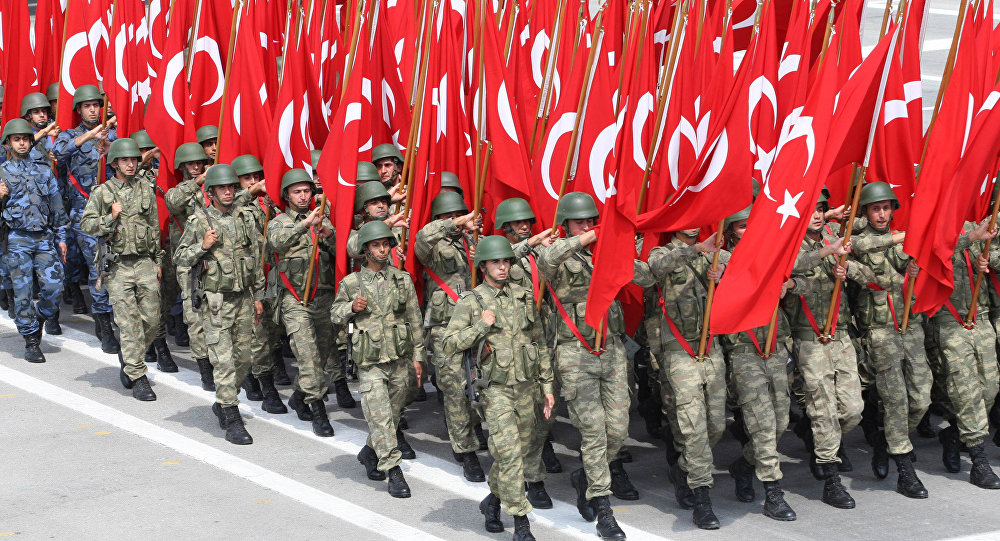 Troops parade with Turkish flag on August 30, 2013 in Ankara during  celebrations for the