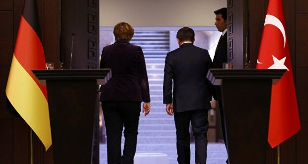 German Chancellor Angela Merkel (L) and Turkish Prime Minister Ahmet Davutoglu leave following a joint news conference in Ankara, Turkey February 8, 2016