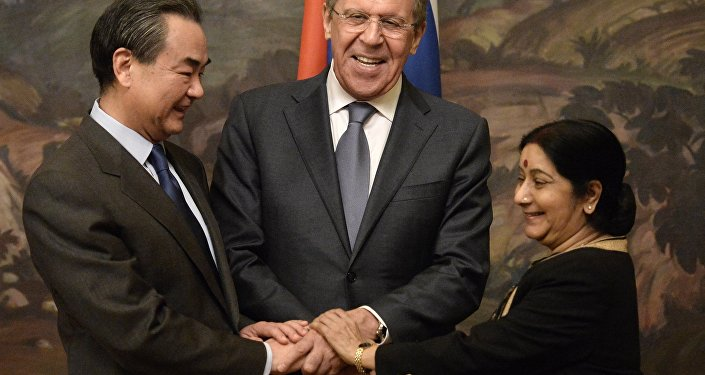 From left: Chinese Foreign Minister Wang Yi, Russian Foreign Minister Sergei Lavrov and Indian Foreign Minister Sushma Swaraj during are photographed before a plenary meeting of the foreign ministers of Russia, India and China (RIC) in the Reception House of the Russian Foreign Ministry.