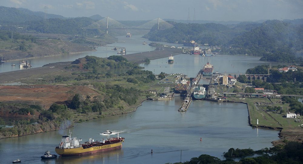 In this May 11, 2016 file photo, ships transit through the Panama Canal near Panama City