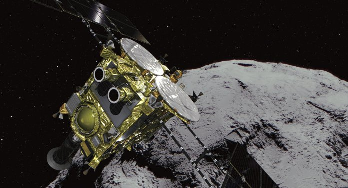 This computer graphics image provided by the Japan Aerospace Exploration Agency (JAXA) shows an asteroid and asteroid explorer Hayabusa2.