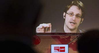 Edward Snowden, a former CIA worker before turning whistleblower, speaks via satellite at the IT fair CeBIT in Hanover, Germany, Tuesday March 21, 2017