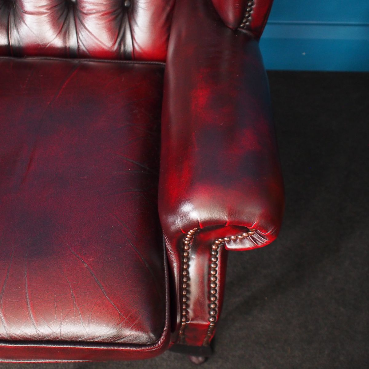 oxblood leather wing chair short directors british vintage wingback chesterfield armchairs in