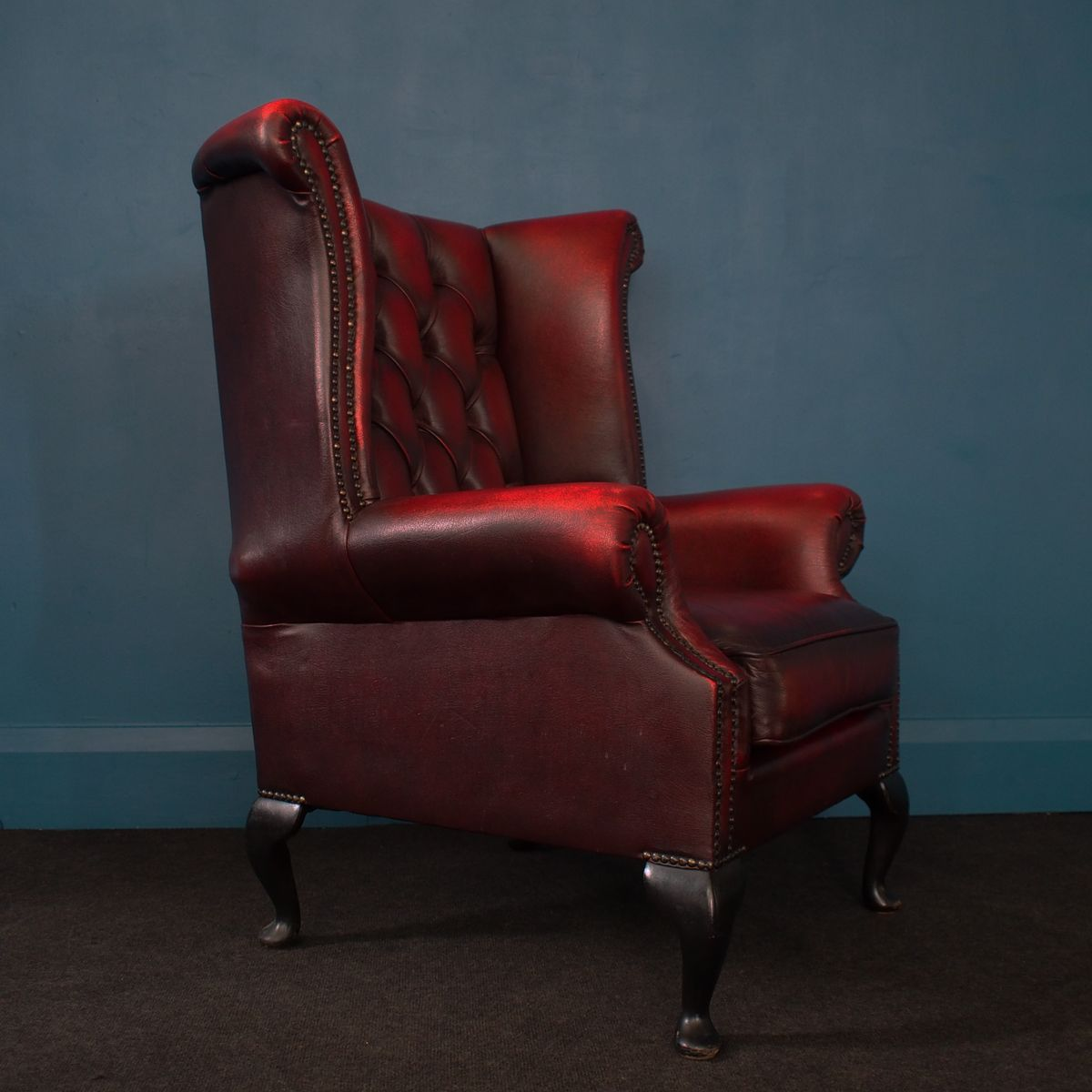 oxblood leather wing chair infant for bathtub british wingback chesterfield armchair