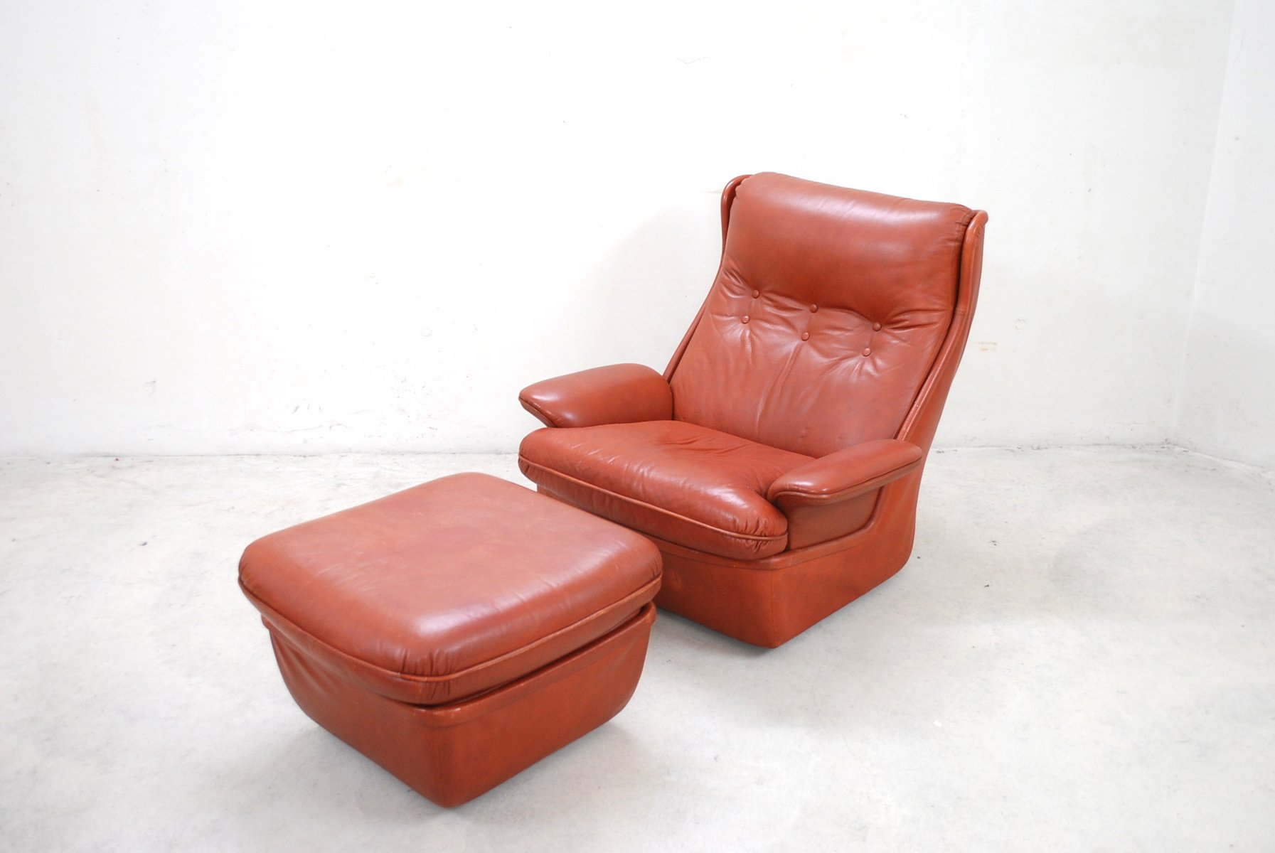 red leather chair and ottoman swivel office base lounge chairs from airborne for