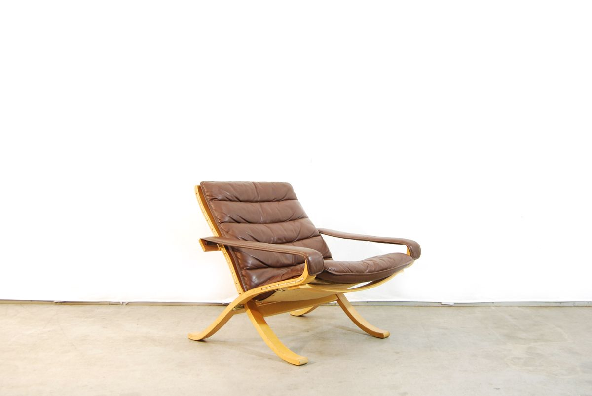 flex one folding chair hanging very scandinavian lounge chairs and ottoman by