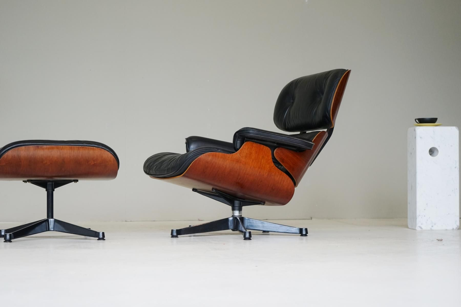 herman miller leather chair gym chairs cost lounge with matching ottoman by charles