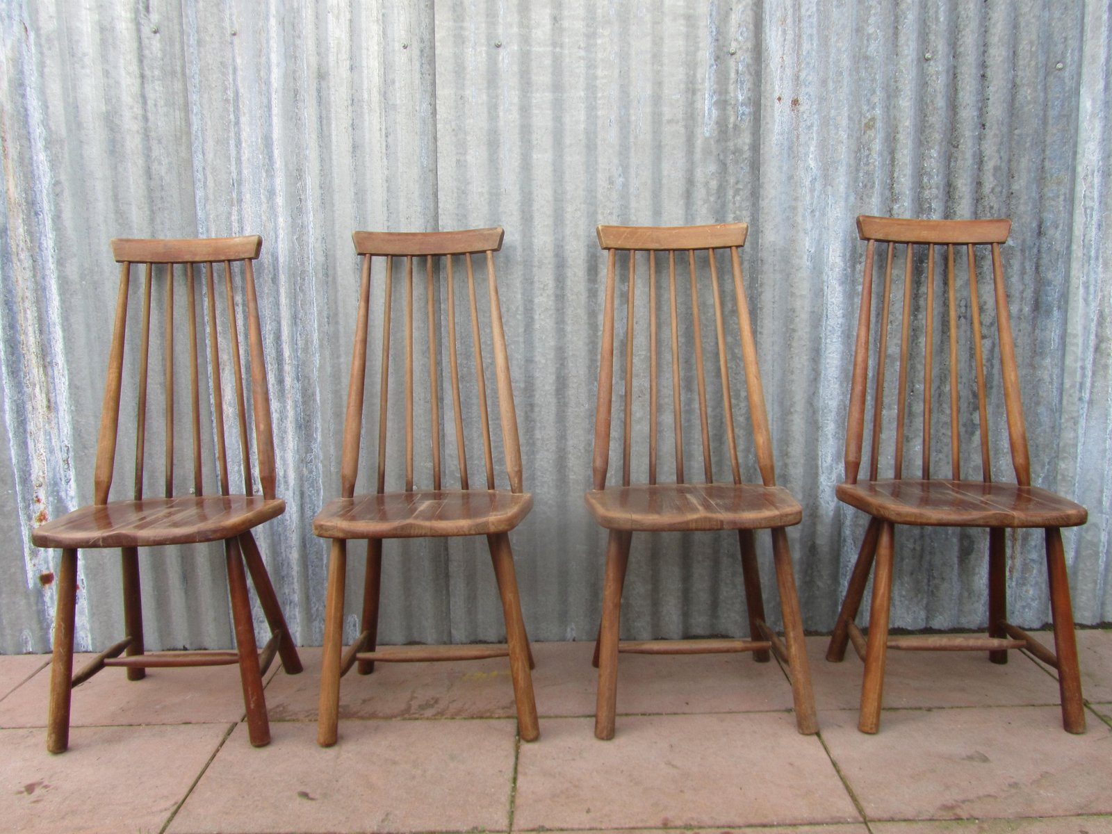 swedish high chair black leather chaise lounge mid century back spindle chairs set of 4 for