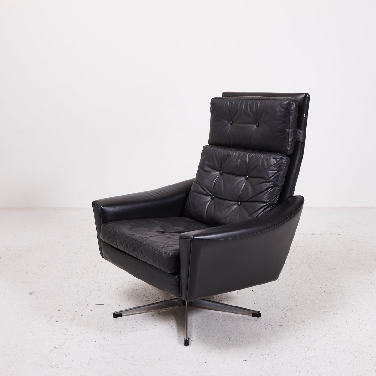 swivel chair black wedding reception types leather with star shaped stand 1970s