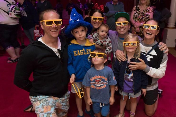 "Guests in 3D glasses pose at ""Mickey's PhilharMagic"" at Disney California Adventure park"