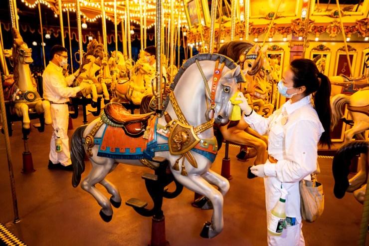 Cast members clean Cinderella Carousel at Hong Kong Disneyland
