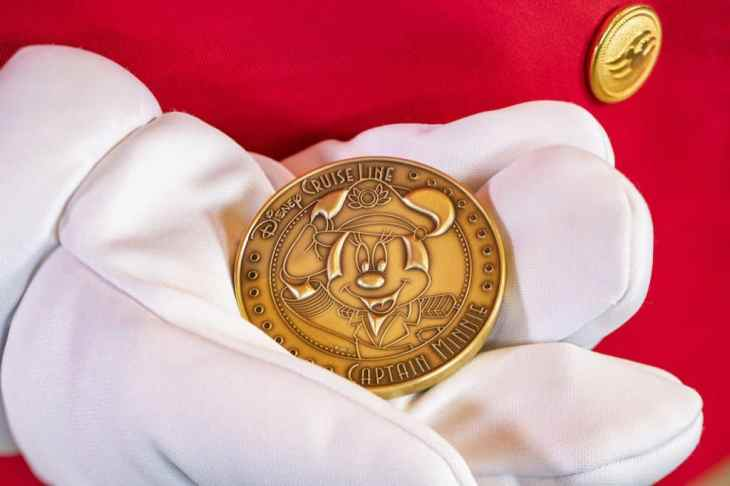 Close up of the minted coin featuring Captain Minnie Mouse that is placed under the keel of the new Disney Wish