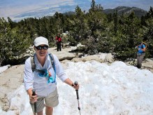 Joan climbs the final snow patch at the summit