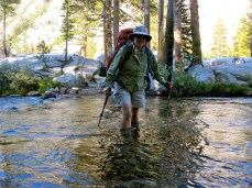 Wading across Bear Creek