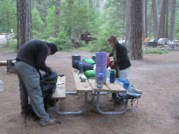 Final adjustments before leaving backpacker's campground