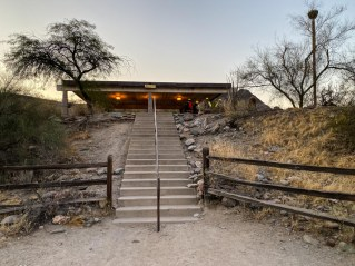 Steps up from parking to a picnic shade structure