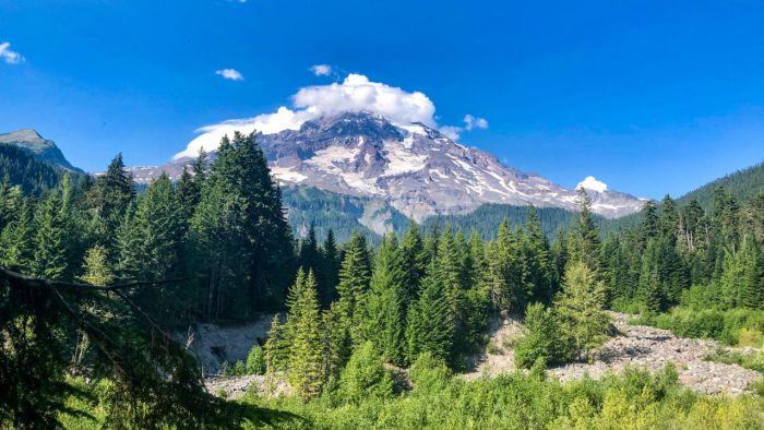 Looking up at Mount Rainier as we cross Kautz Creek