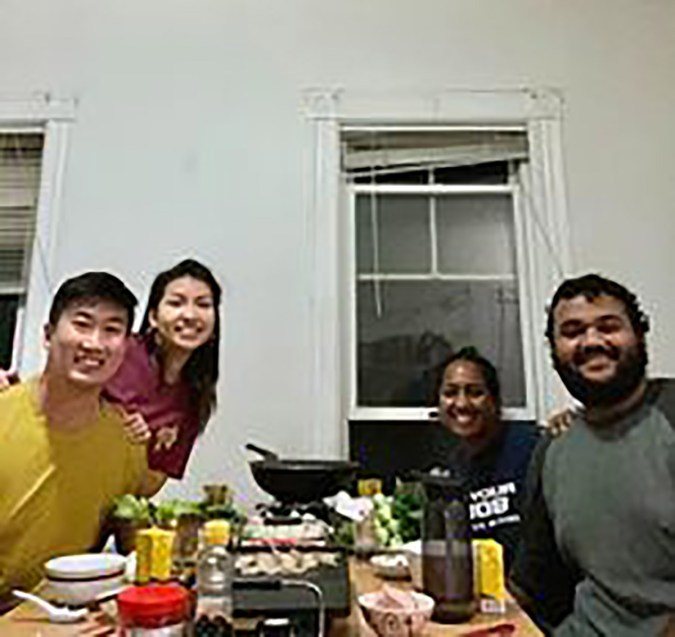 4 students cooking dinner together