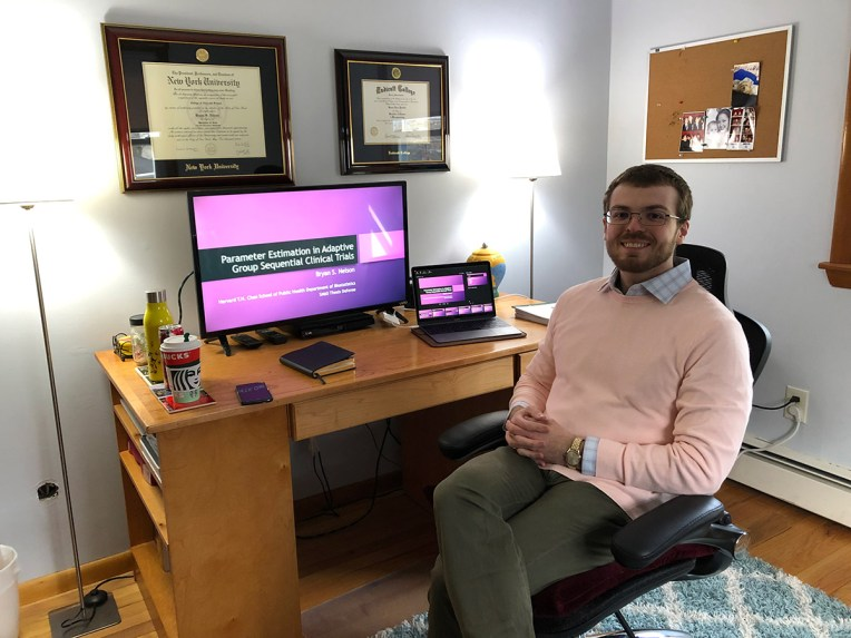 Student Bryan Nelson sits in front of computer in office