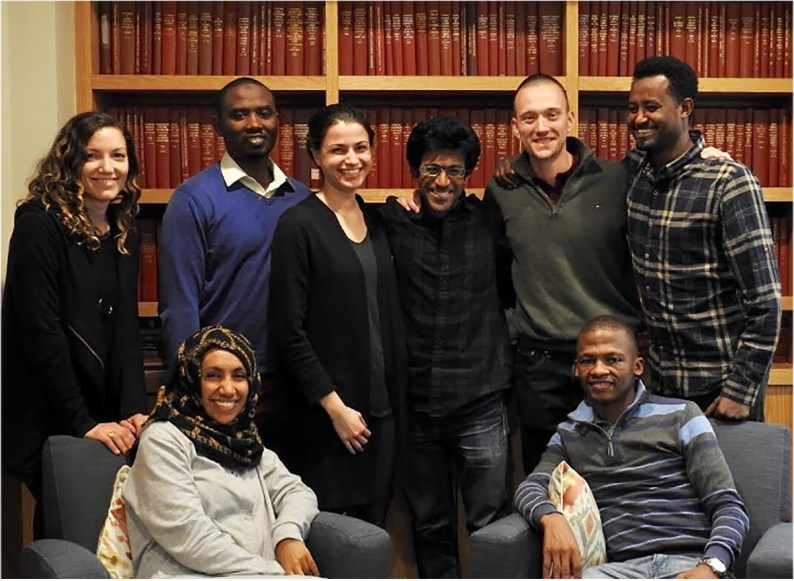 A group of students pose in a library before the pandemic