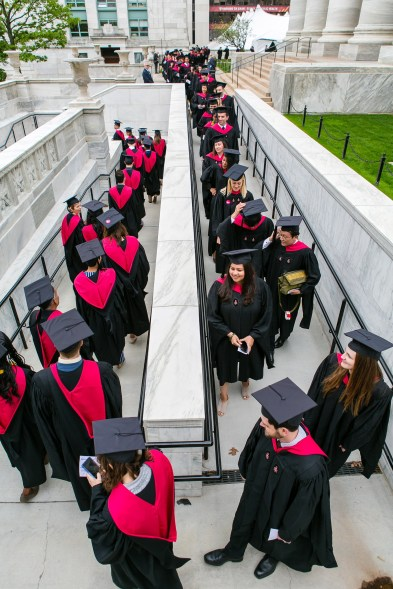 Students walking to tent