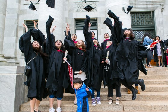 Students throwing caps in the air