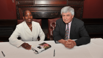 Unity Dow and Max Essex at the book signing table