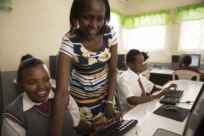 NAIROBI, KENYA - NOVEMBER 6 : DAMARIS, CAROLINE, AND SEVERAL STUDENTS WORKING ON APP IN COMPUTER LAB IN EMBAKASI GIRLS HIGH SCHOOL IN MUKURU AREA. Photo by Guillaume Bonn/ Getty Images Assignment for intel