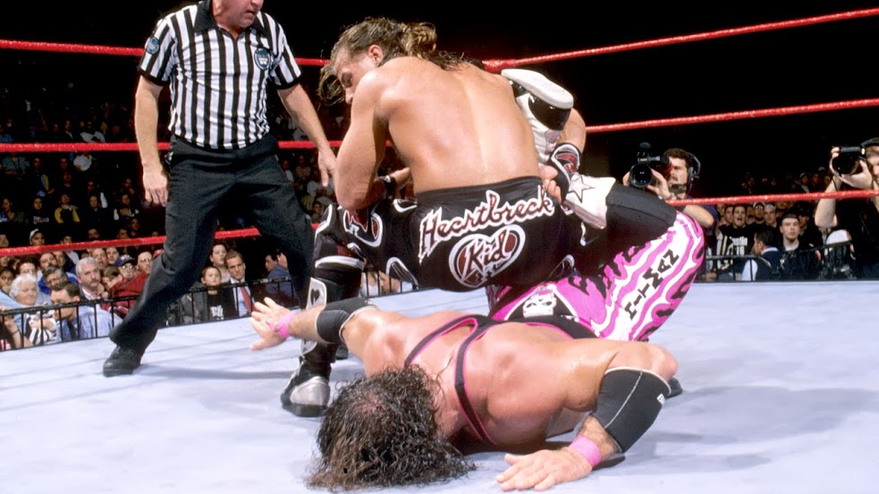 Bret Hart tapping to Shawn Michaels