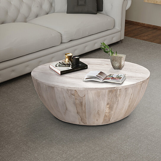 saltoro sherpi distressed mango wood coffee table in round shape washed light brown