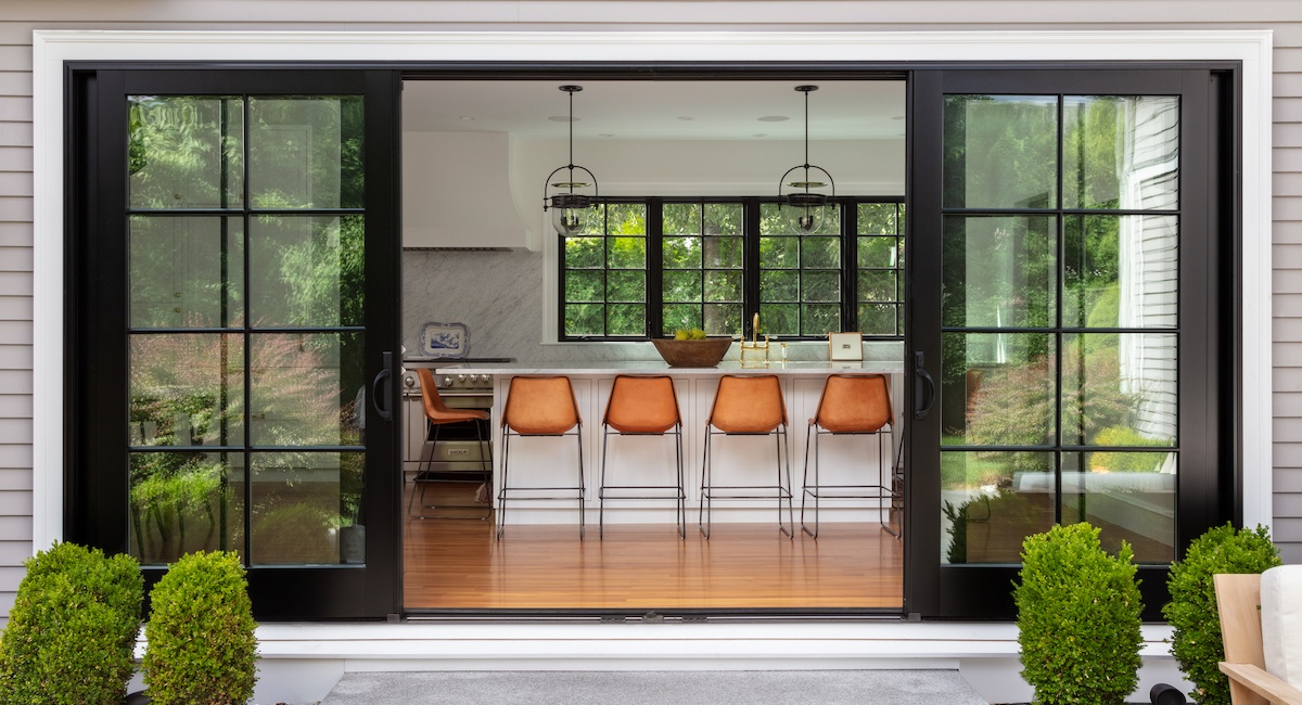 this bright white kitchen features a
