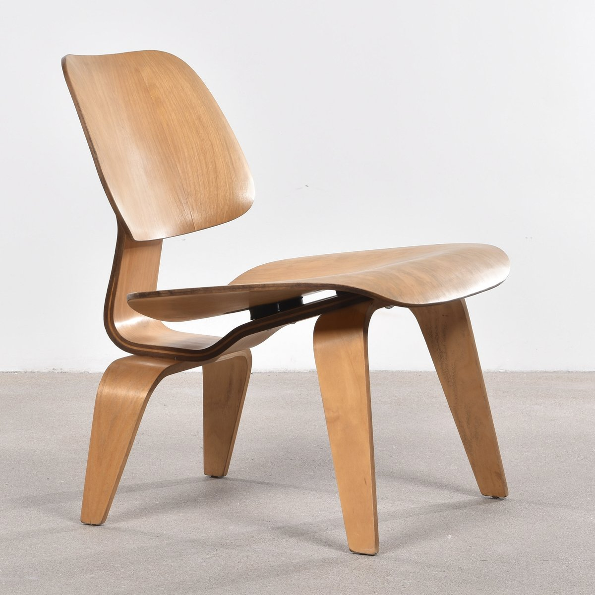 eames lcw chair wheelchair elderly american oak lounge by charles and ray for
