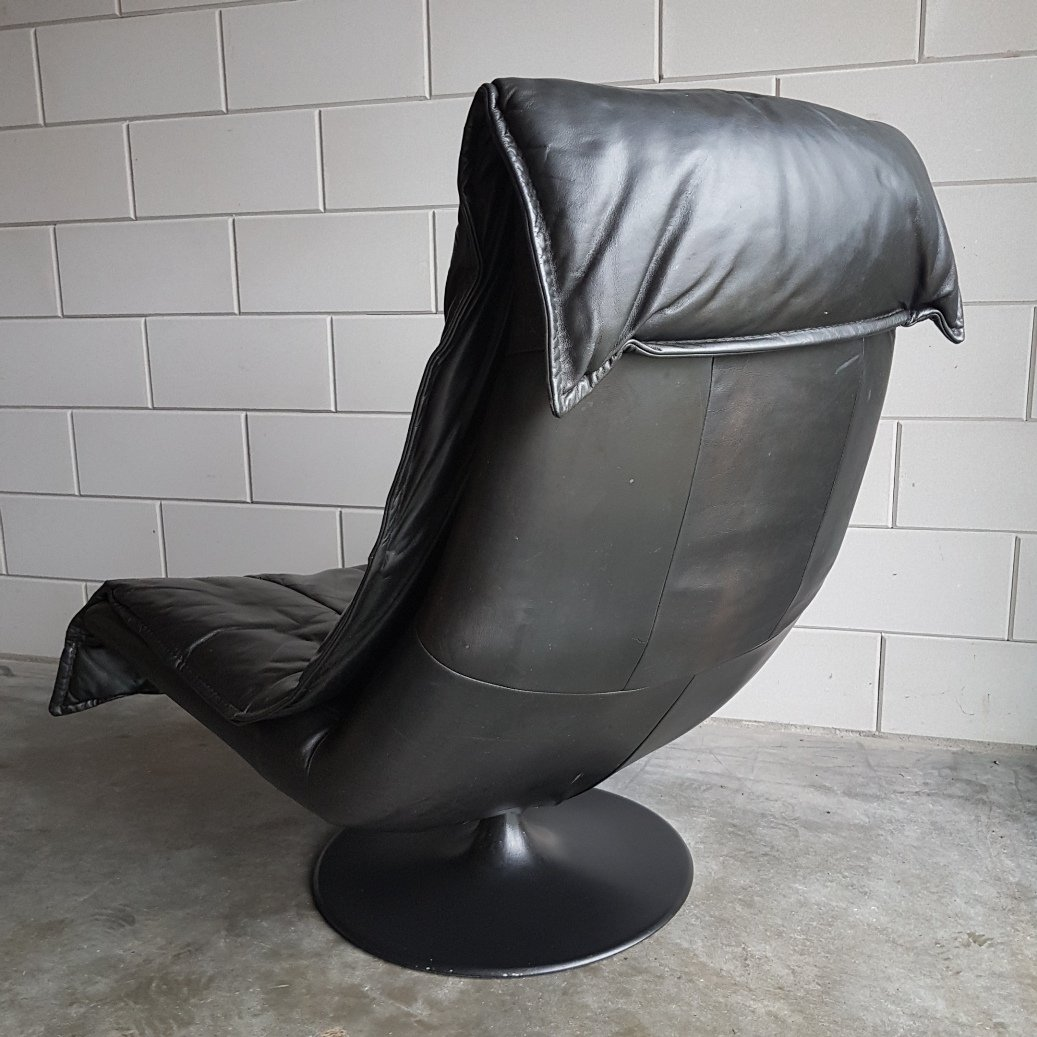 swivel chair em portugues bedroom for sale vintage large black leather lounge with