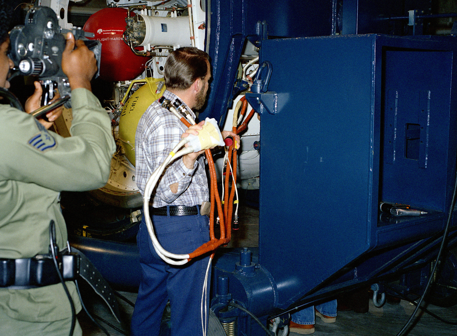 hight resolution of technicians feed the wire harness into the topside of the stage four destruct package for the