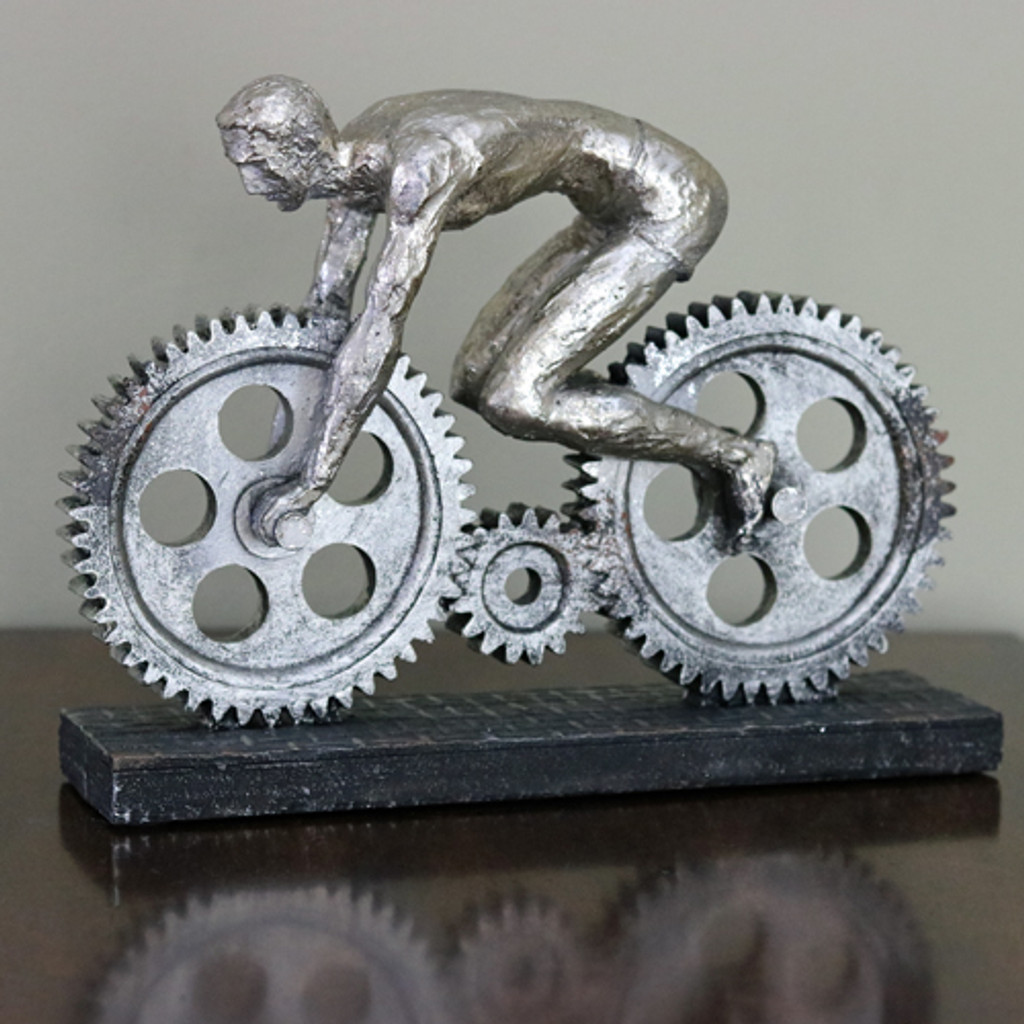 industrial gear cyclist sculpture