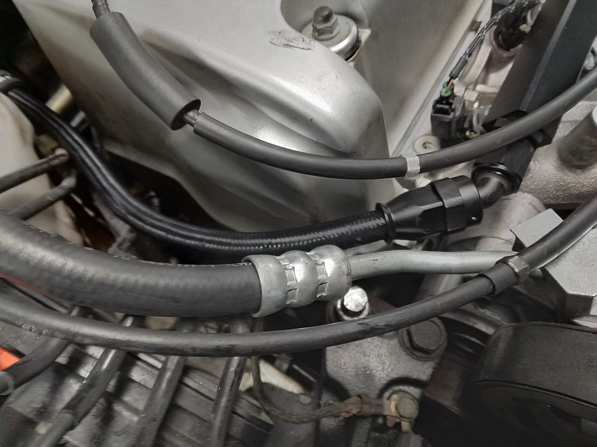 hight resolution of feed line as it connects to the fuel rail requires the power steering hose to
