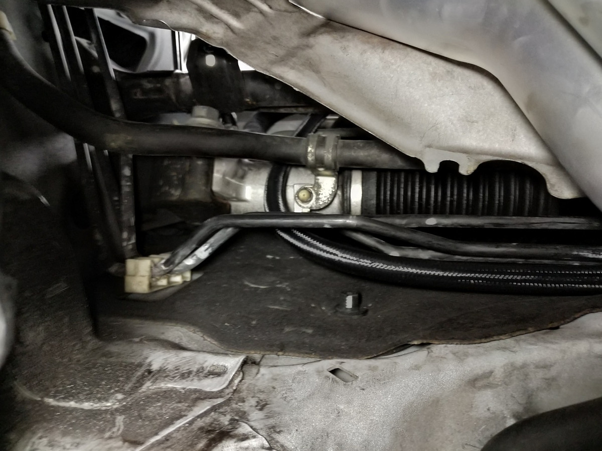 hight resolution of feed line routed against the fire wall behind the oem heat shield
