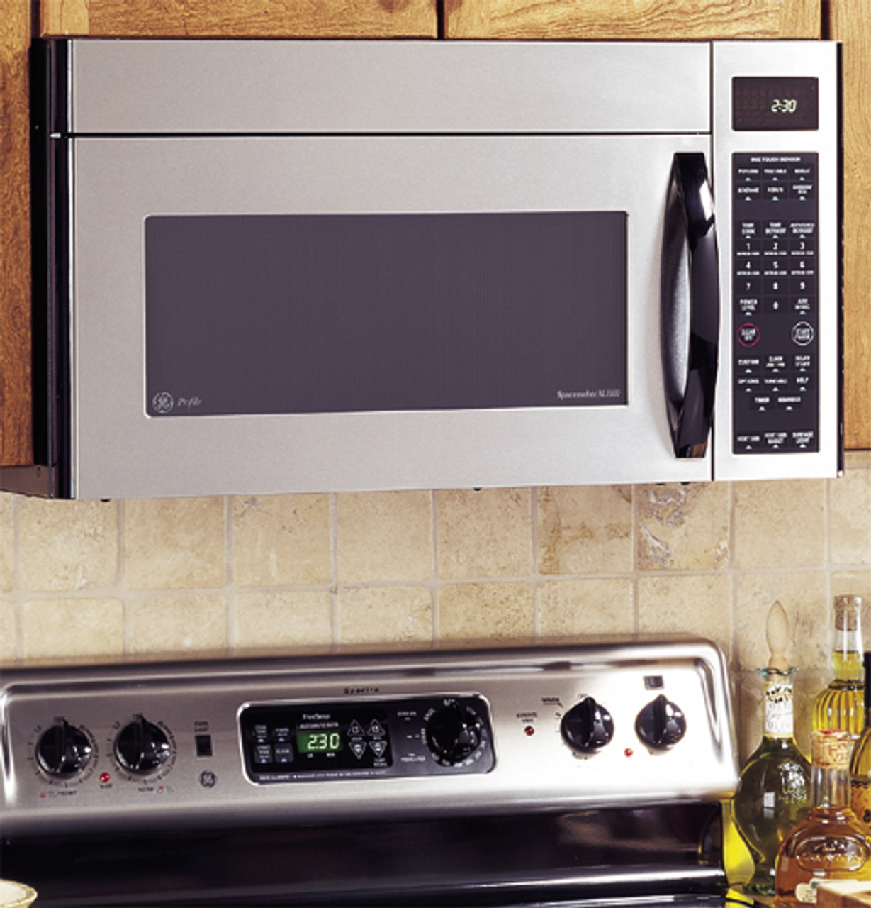ge profile spacemaker xl1800 microwave oven with recirculating venting 1100 watts jvm1861sf