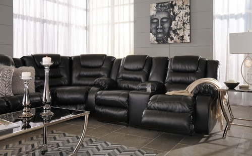 black reclining sofa with console er leather ashley vacherie wedge double loveseat sectional