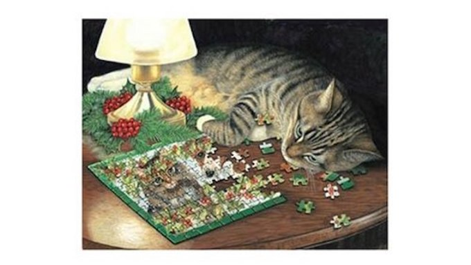 Cat napping on jigsaw