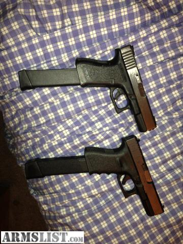 ARMSLIST  For Sale glock 23 w extended clip and lazer