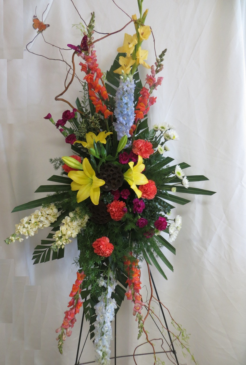 Heavenly Solace Funeral Spray Of Flowers In Yellows Blues