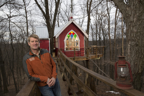 "Pete Nelson, owner of Nelson Treehouse and Supply, poses by a Ohio brewery treehouse he designed on Animal Planet's ""Treehouse Masters."" New episodes of the popular TV show begin on May 30."