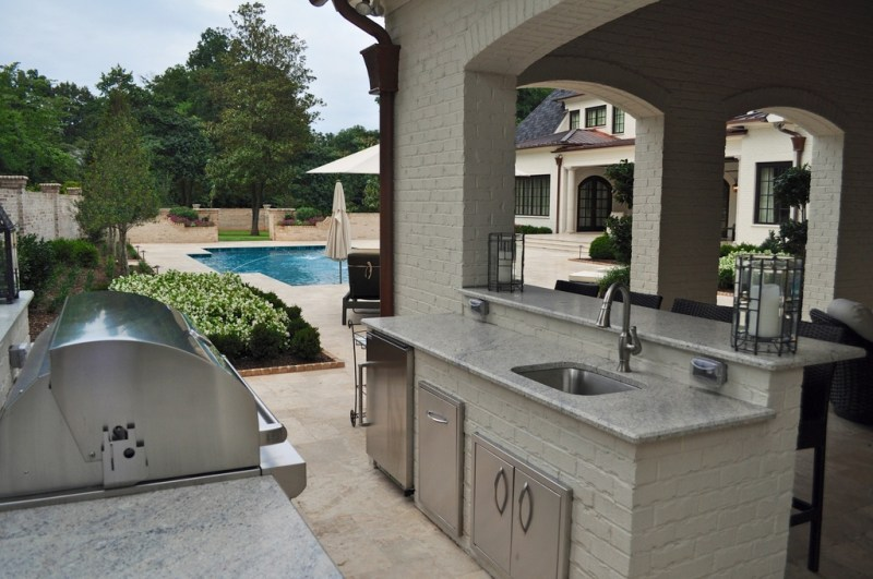 traditional-patio-with-outdoor-kitchen-i_g-IS95ufzpnv9lp30000000000-L0r_G