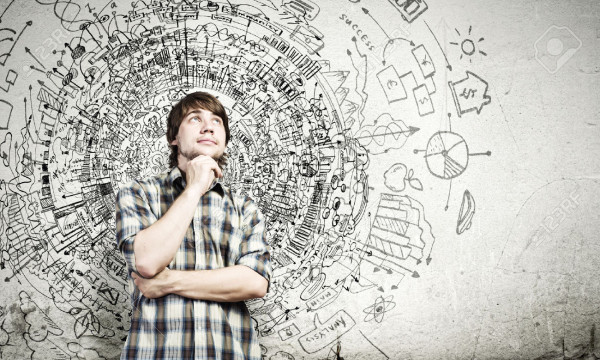 24976624-Young-thoughtful-handsome-man-in-casual-thinking-over-the-ideas-Stock-Photo