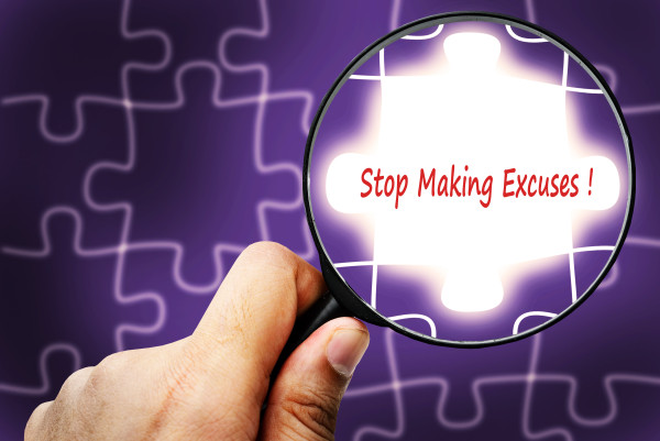 Stop Making Excuses word. Magnifier and puzzles.