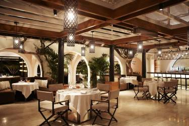 hotel bel air wolfgang puck angeles expensive los most restaurants dining outdoor room brunch beverly hills night romantic rockwell credit