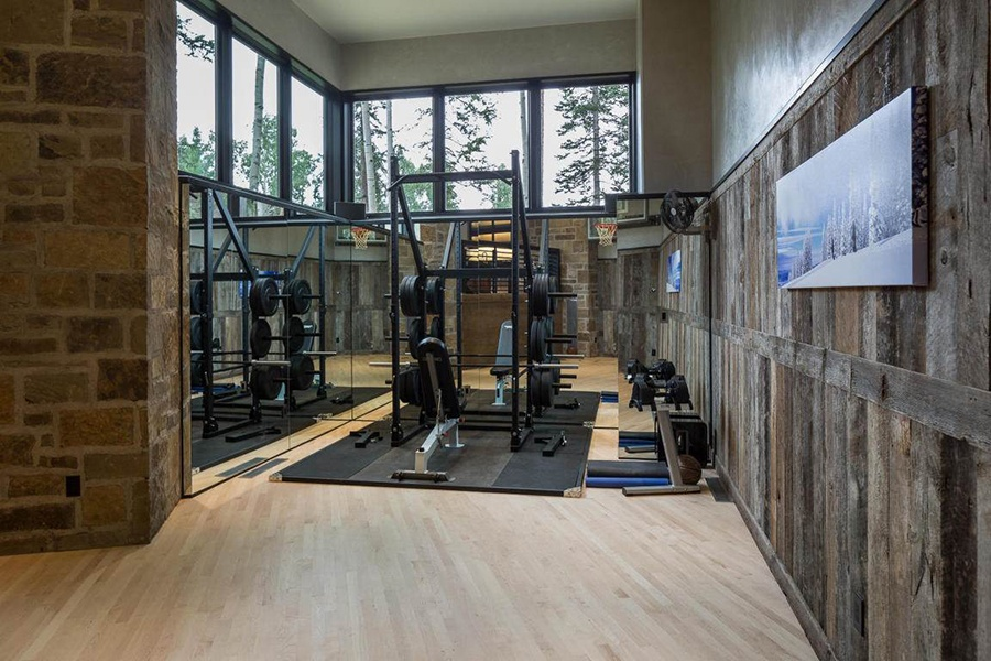 Enjoy an après-ski workout with a view of the trees outside the windows of this Telluride estate, which also has an indoor basketball court.
