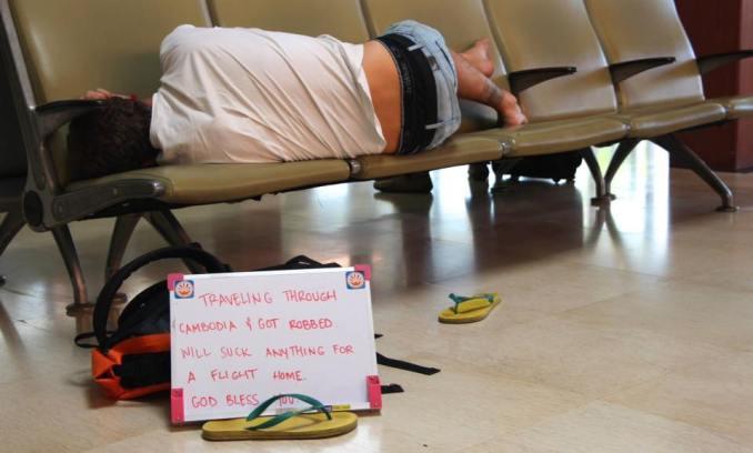 traveler-sleeping-in-airport